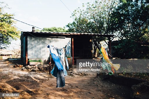 Clothes hanging out to dry in front of a home in rural village in Nicaragua : Stock Photo