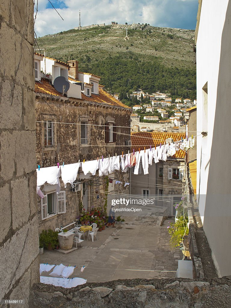 Clothes line inbetween the inhabited ancient houses of the UNESCO World Heritage Site city of Dubrovnik on the Dalmatian coast of the Adriatic Sea on May 13, 2011 in Dubrovnik, Croatia. More than 2400 people live in the historical houses. The old town is surrounded by a 1,9 km long city wall and called the Pearl of the Adriatic.