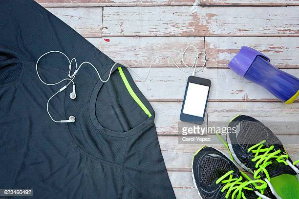 Clothes make running with isotonic drink, phone and T-shirt  Image
