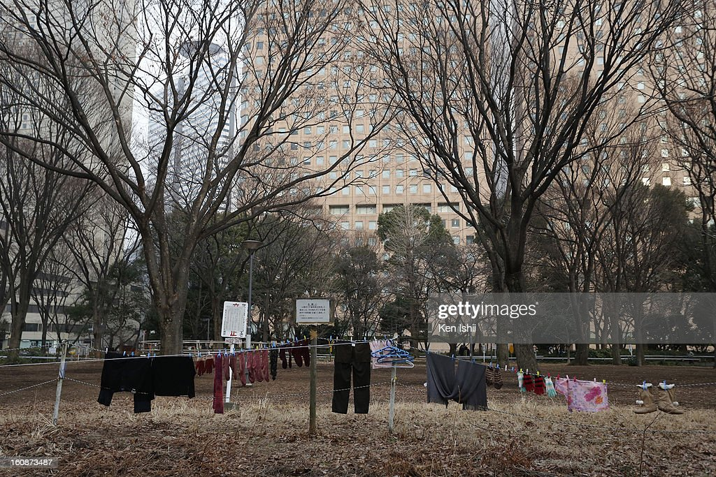Clothes of homeless people are hung to dry at Shunjuku Central Park on February 7, 2013 in Tokyo, Japan. A recent servey shows Tokyo as the most expensive city in the world and Osaka ranked second.