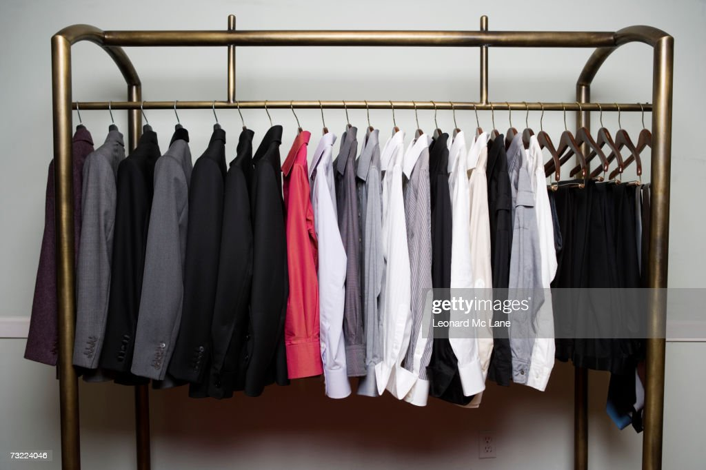 Clothes on rack, close-up : Stock Photo