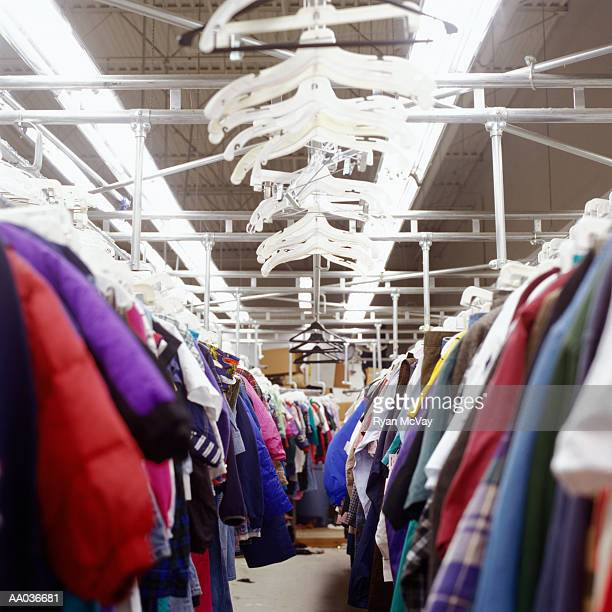 Clothes racks with plastic hangers, low angle view