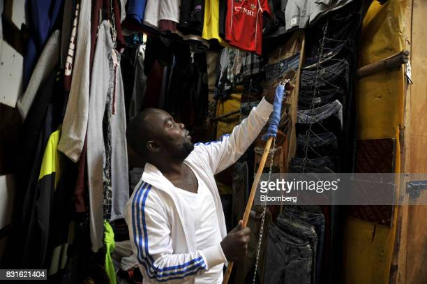 A clothes trader prepares his shop display following post election unrest inside the Toi market in the outskirts of Kibera slum in Nairobi Kenya on...