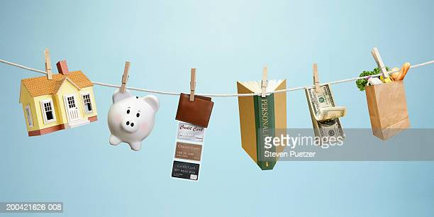 Clothesline with various household and financial objects