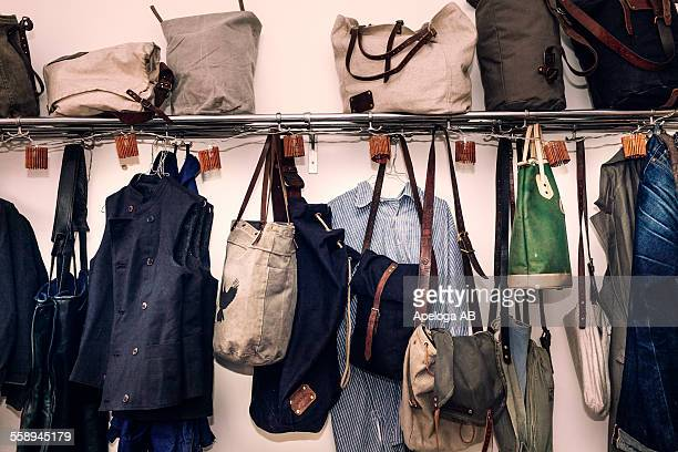Clothing and bags hanging in workshop