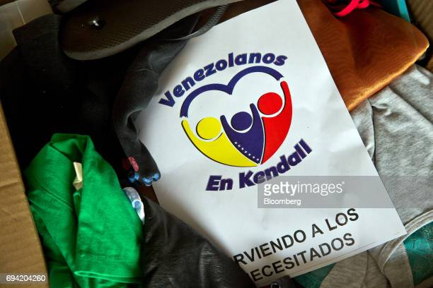 Clothing and shoes collected to aid protesters by the Venezuelan exile group Politically Persecuted Venezuelans in Exile sit in a box before being...
