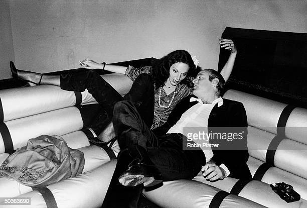 Clothing designer Diane Von Furstenberg lounging intimately w boyfriend media mogul Barry Diller at Studio 54