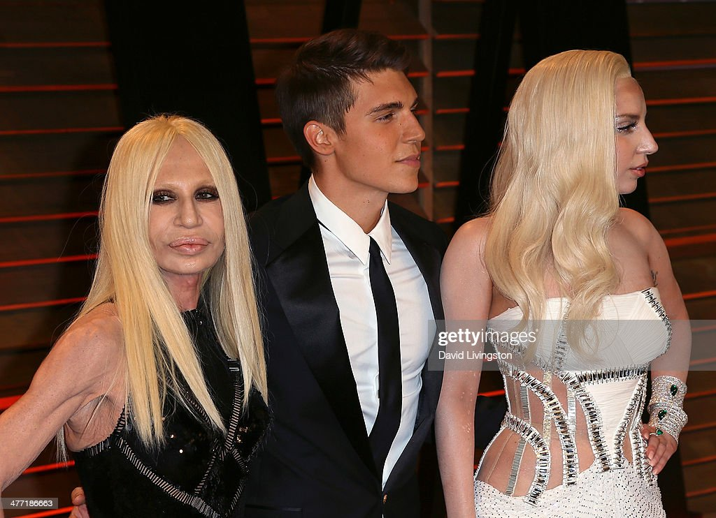 Clothing designer Donatella Versace, actor Nolan Gerard Funk and recording artist Lady Gaga attend the 2014 Vanity Fair Oscar Party hosted by Graydon Carter on March 2, 2014 in West Hollywood, California.