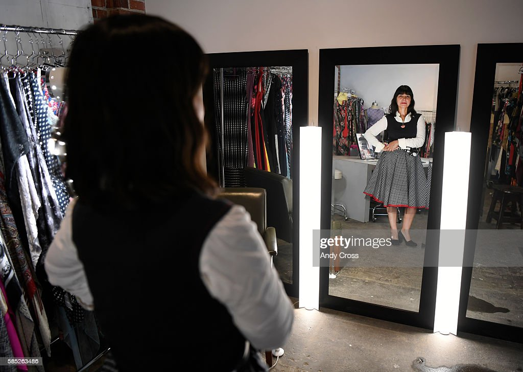 Clothing designer Mona Lucero in her studio wearing her design a black top a black and white twill print circle skirt with a tulle under layer August...