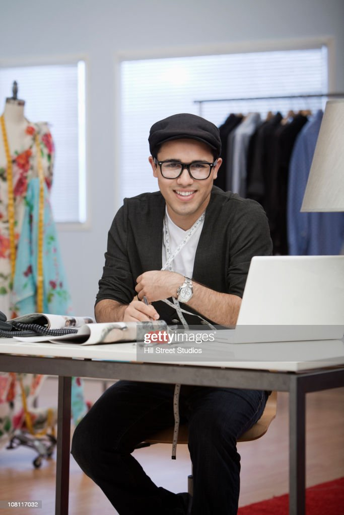 Clothing designer working in workshop : Stock Photo