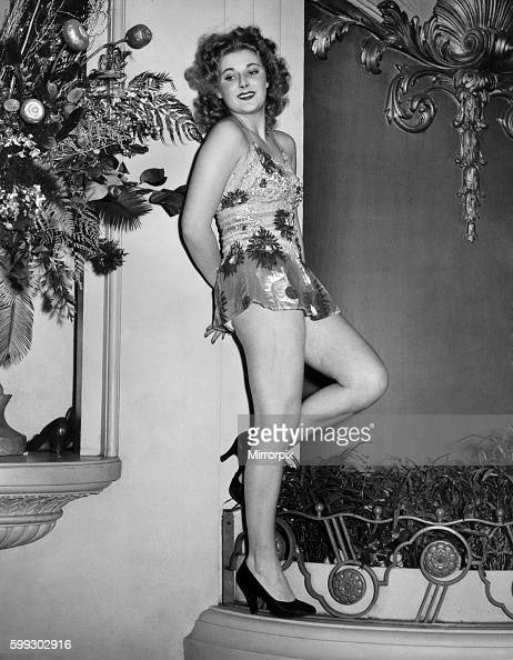 Fashion gala at Grosvenor House Model poses amongst the flowers in either a flowery mini dress or swimming costume and court shoes December 1939...