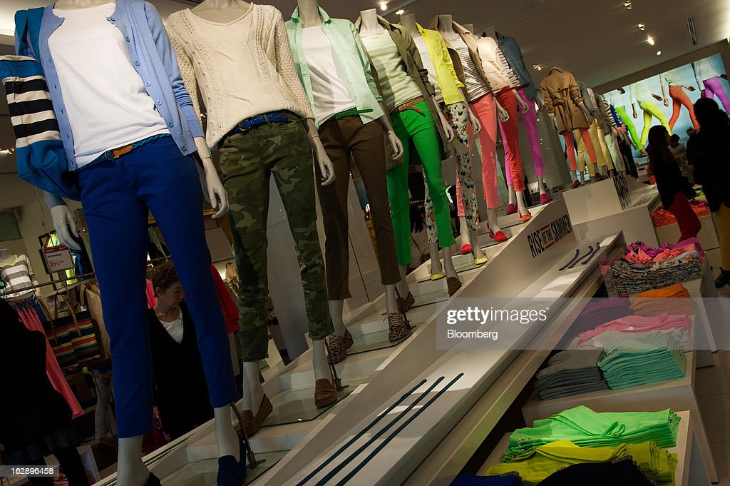 Clothing is displayed for sale in a store in the shopping district of Omotesando in Tokyo, Japan, on Friday, March 1, 2013. Japan's consumer prices fell for the eighth time in nine months, highlighting the challenges facing the Bank of Japan in reaching a 2 percent inflation target. Photographer: Noriko Hayashi/Bloomberg via Getty Images