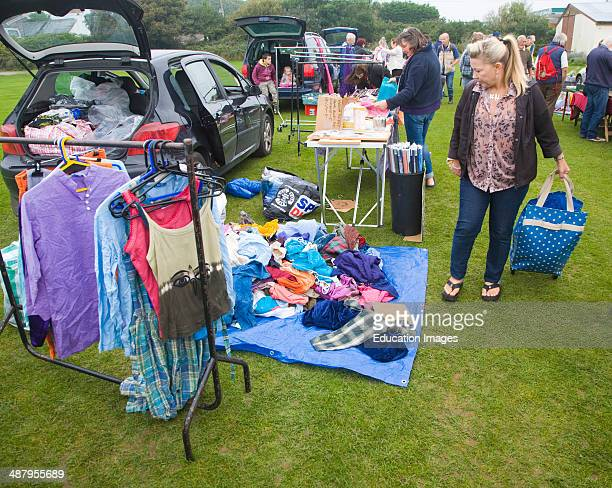 Clothing on display at a car boot sale UK