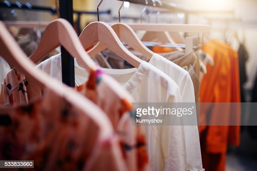 Clothing on hanger at the modern shop boutique : Stock Photo