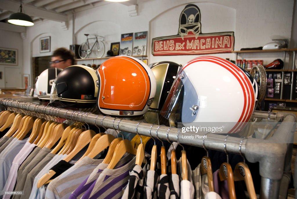 clothing rack and helmets at deus ex machina clothing shop. Black Bedroom Furniture Sets. Home Design Ideas