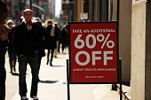 A clothing sale sign stands outside of a store in Manhattan on March 12 2015 in New York City For a third straight month in February US retail sales...