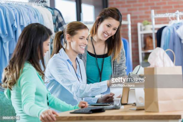 Clothing store manager trains new employees