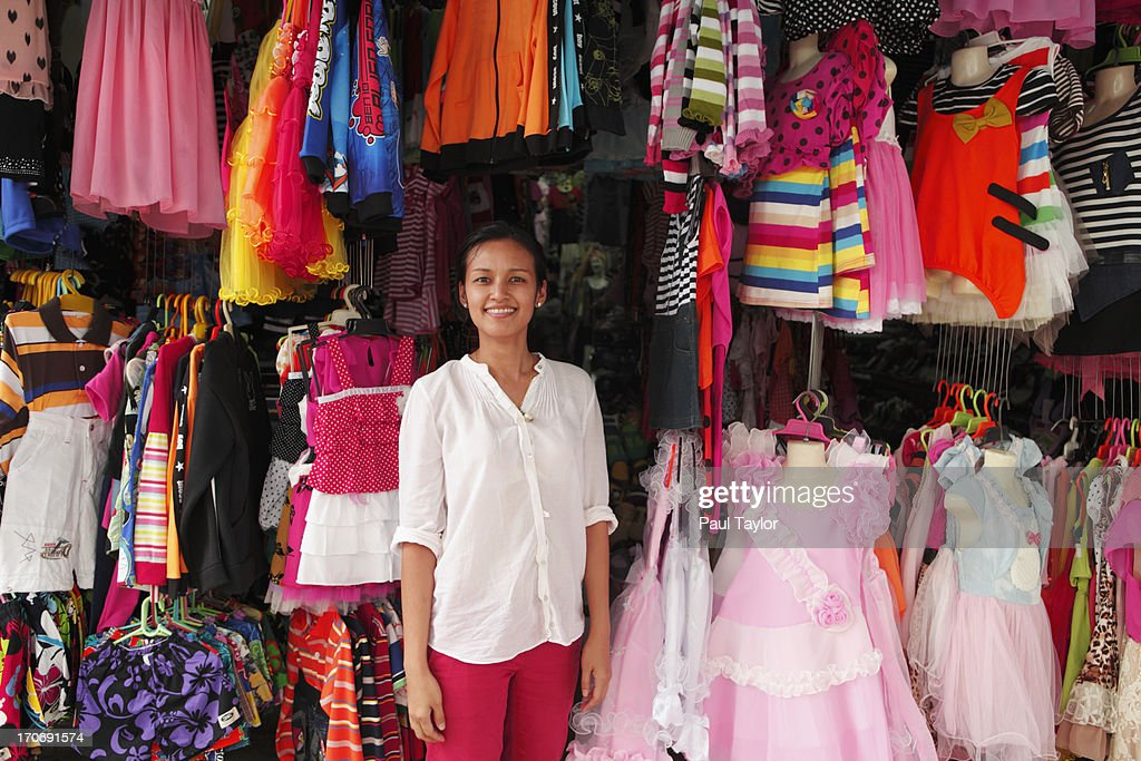 Clothing Store with Woman : Stock Photo