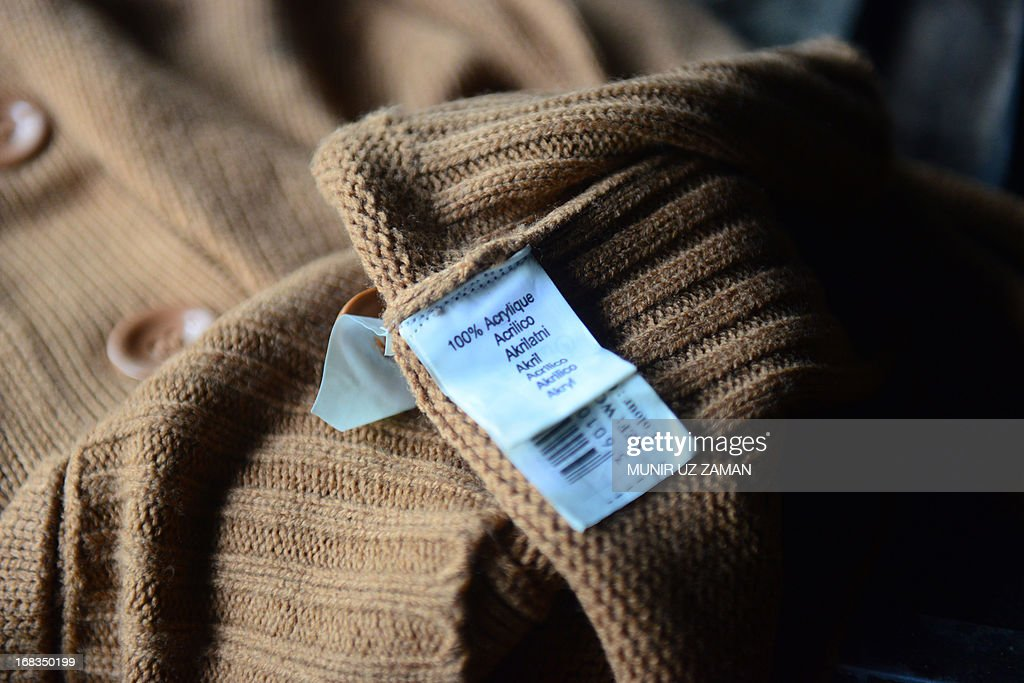 A clothing tag is seen inside a gutted garment factory in Dhaka on May 9, 2013. A fire at a garment factory killed at least eight people May 9 in the latest disaster to hit Bangladesh's textile industry, still reeling from the deaths of more than 900 people in a building collapse. AFP PHOTO/Munir uz ZAMAN