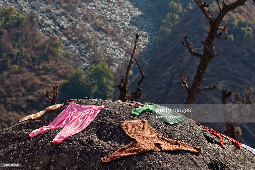 Clothing to dry on a large rock : Stock Photo