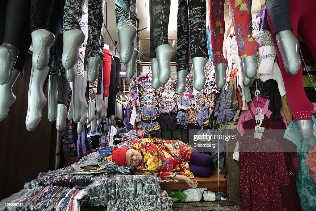 A clothing vendor takes a nap at her stall at the Cipulir market in Jakarta, Indonesia, on Friday, Jan. 18, 2013. Indonesia declared a state of emergency in Jakarta as flooding brought traffic to a standstill in the city of 9.6 million people and swamped the offices of President Susilo Bambang Yudhoyono. Photograph by: Dimas Ardian/Bloomberg via Getty Images