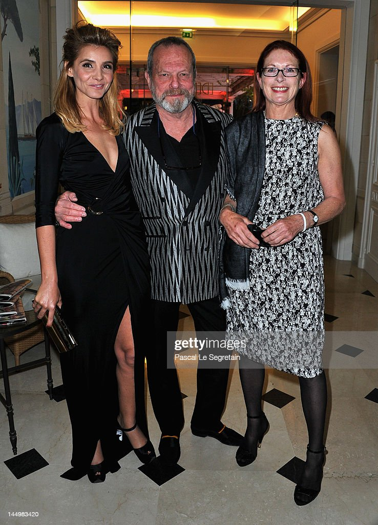 Clotilde Courau, American-born British screenwriter, film director Terry Gilliam and his wife Maggie Weston arrive at the exclusive Filmmakers Dinner during the Cannes International Film Festival hosted by Swiss watch manufacturer IWC Schaffhausen in partnership with Finch's Quarterly Review at the famous Hotel du Cap-Eden-Roc on May 21, 2012 in Cap d'Antibes, France.