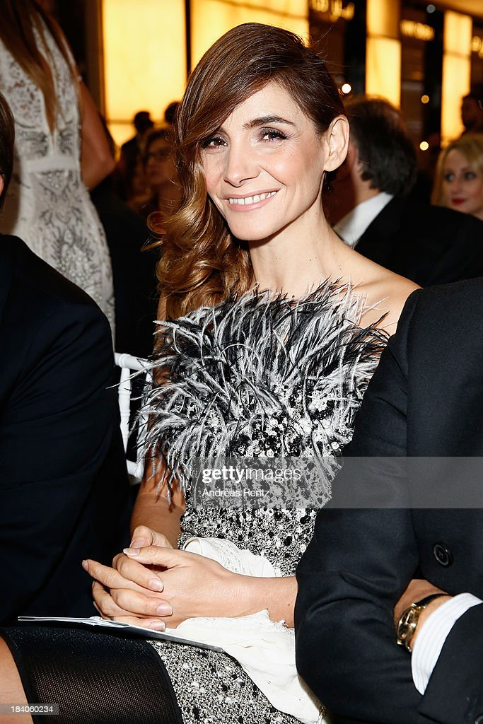 <a gi-track='captionPersonalityLinkClicked' href=/galleries/search?phrase=Clotilde+Courau&family=editorial&specificpeople=171279 ng-click='$event.stopPropagation()'>Clotilde Courau</a> arrives at the catwalk show during the Vogue Fashion Dubai Experience at Dubai Mall on October 10, 2013 in Dubai, United Arab Emirates.