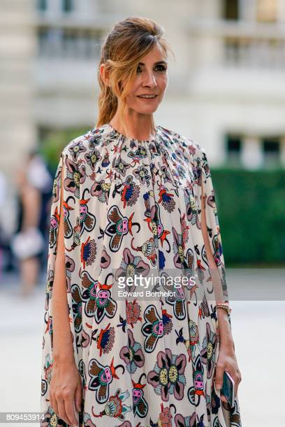 Clotilde Courau wears a flower print dress after the Valentino show during Paris Fashion Week Haute Couture Fall/Winter 20172018 on July 5 2017 in...