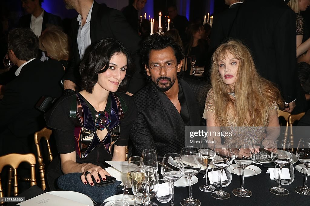 Clotilde Hesme, Haider Ackermann and Ariel Dombasle attend the Babeth Djian Hosts Dinner For Rwanda To The Benefit Of A.E.M. on December 6, 2012 in Paris, France.
