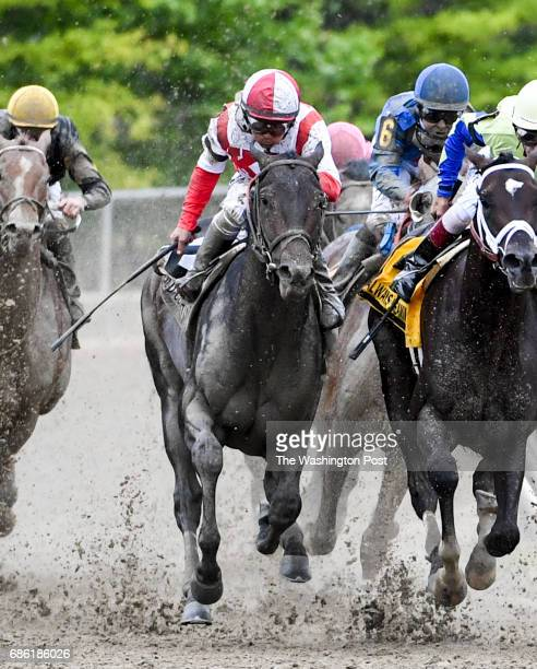 Cloud Computing Center with red and white helmet with jockey Javier Castelland breaks out of the pack on the fourth turn to be a Classic Empire at...