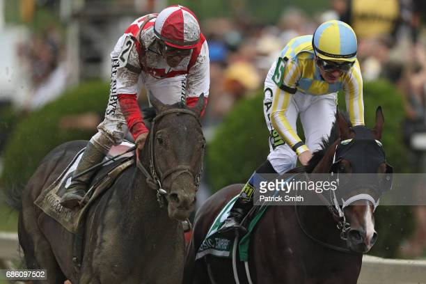 Cloud Computing ridden by Javier Castellano beats Classic Empire ridden by Julien Leparpux to win the 142nd running of the Preakness Stakes at...