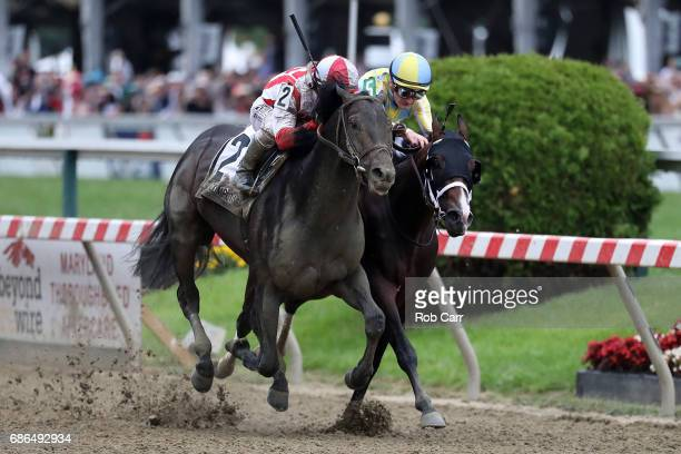 Cloud Computing ridden by Javier Castellano beats Classic Empire ridden by Julien Leparoux to win the 142nd Preakness Stakes at Pimlico Race Course...