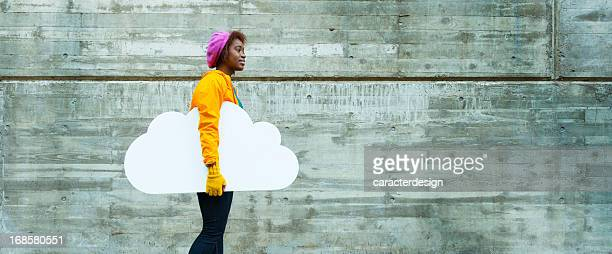 Cloud computing: young woman in urban scene