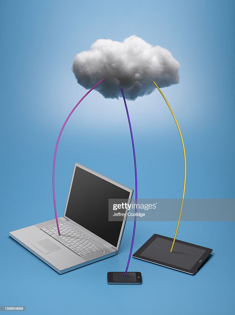 Cloud Connected to Three Devices : Stock Photo
