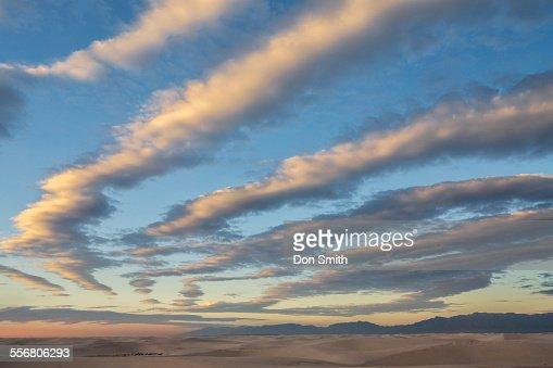 Cloud Fingers Over Dunes