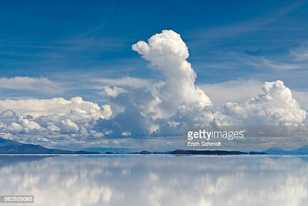 Cloud formations with reflections in the salt lake, Salar de Uyuni, near Phaspani, Potosi, Altiplano, Bolivia