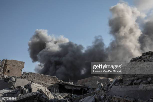 A cloud from an explosion near alNuri mosque complex on June 29 2017 in Mosul Iraq The Iraqi Army Special Operations Forces and CounterTerrorism...