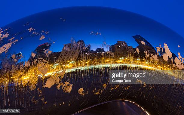 'Cloud Gate' a reflective polished metal sculpture by British artist Anish Kapoor located in Millennium Park is coated in ice and snow on March 2...