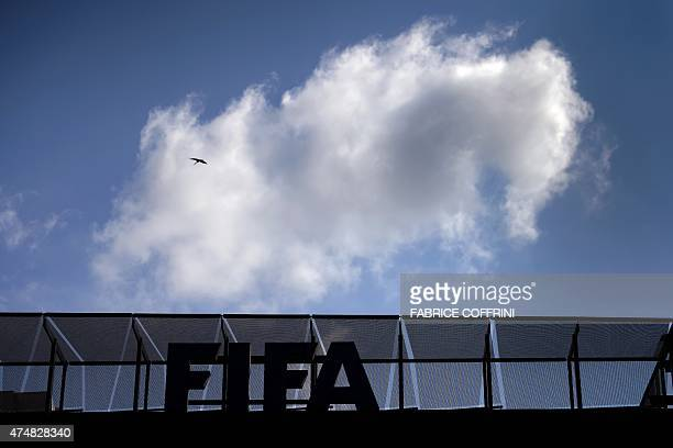 A cloud is seen above the headquarters of international football's top body FIFA on May 27 2015 in Zurich Swiss policeraided a Zurich hotel to detain...