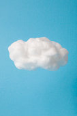 cloud made out of cotton wool on sky blue background.