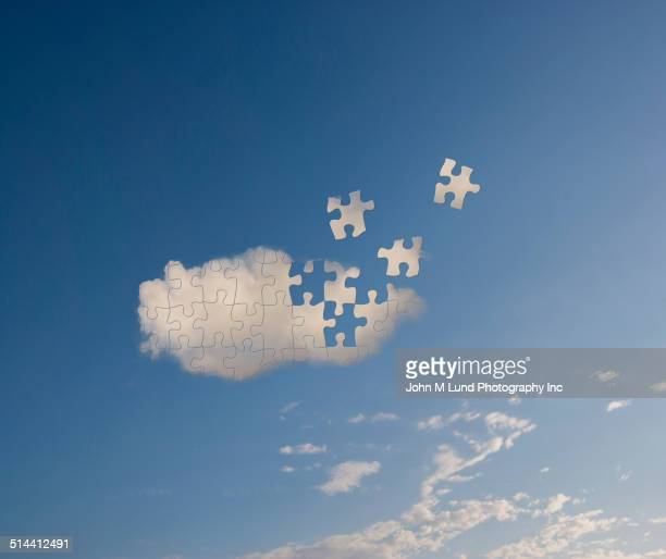 Cloud missing puzzle pieces in blue sky