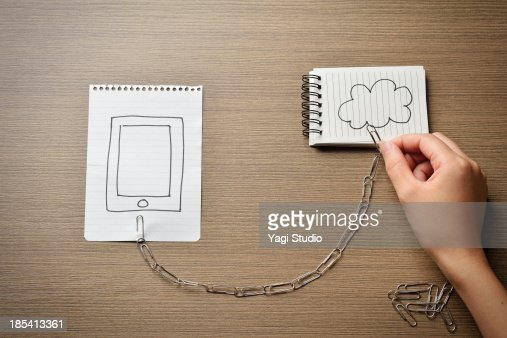 A cloud network and smartphone : Stock Photo