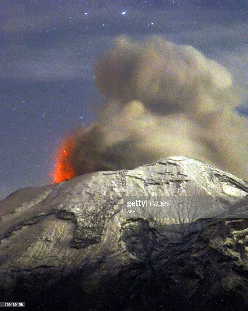 A cloud of ash belches out of Mexico's Popocatepetl volcano, some 55 km from Mexico City, as seen from Paso de Cortes, in the Mexican central state of Puebla, on May 20, 2013. Authorities have raised the alert level to 'Yellow Phase Three,' the fifth of a seven-stage warning system, restricting access to an area of 12 km around the volcano while preparing evacuation routes and shelters. AFP PHOTO/Arturo Andrade