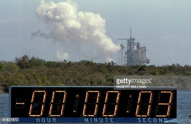 A cloud of smoke drifts from the Space Shuttle Columbia 22 March 1993 after the launch was aborted with three seconds remaining on the countdown...