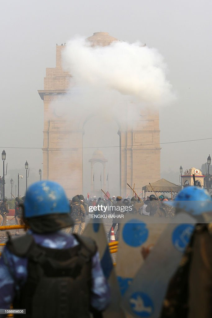 A cloud of smoke from a tear gas canister forms in front of the landmark India Gate monument during a protest calling for better safety for women following the rape of a student last week, in front the India Gate monument in New Delhi on December 23, 2012. In the biggest protest so far, several thousand college students rallied at the India Gate monument in the heart of the capital where they were baton-charged, water cannoned and tear gassed by the police.