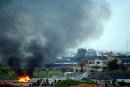 A cloud of smoke rises as a Palestinian's car burns after it was exploded by the Israeli army March 12 2003 outside the West Bank Palestinian town of...