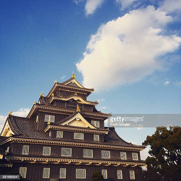 Cloud over Okayama Castle known as Crow Castle for black color first built 1597 rebuilt after destroyed in WWII bombing 1945 Okayama Japan