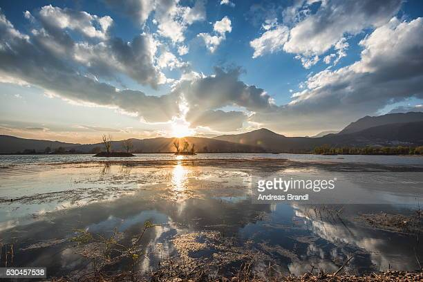 Cloud reflections at a lake in Lijiang, Yunnan, China, Asia