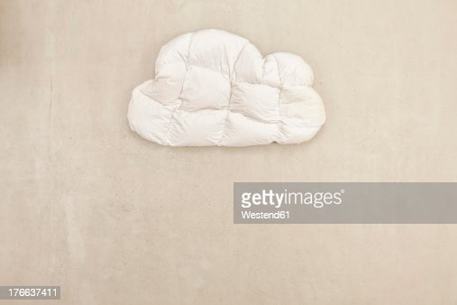 Cloud shape pillow on beige background