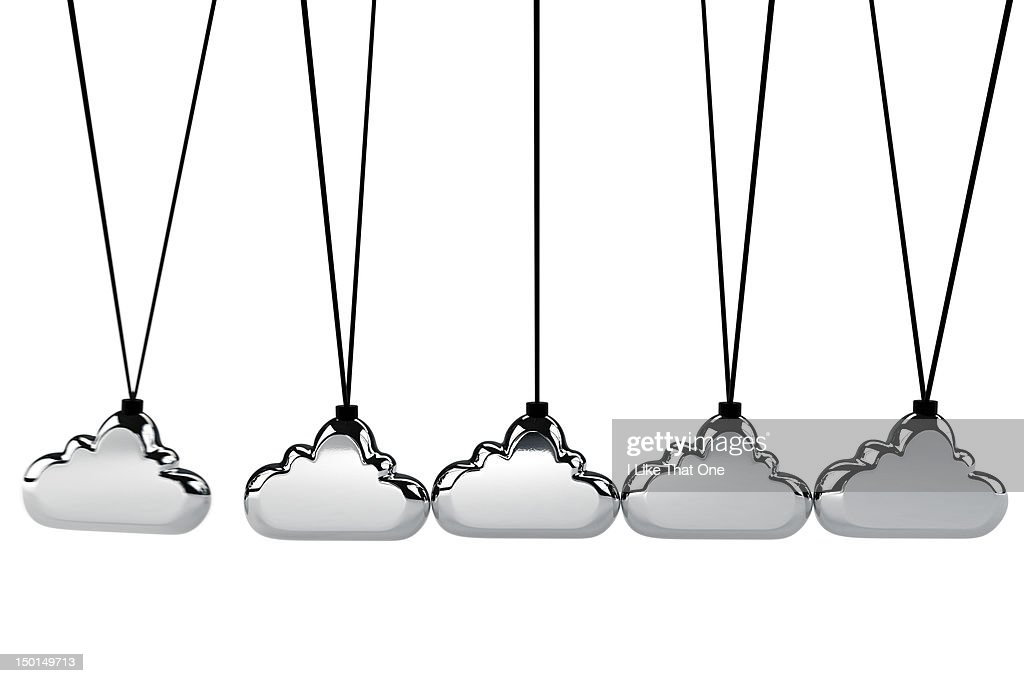 Cloud shaped chrome icons on a Newton's cradle : Stock Photo